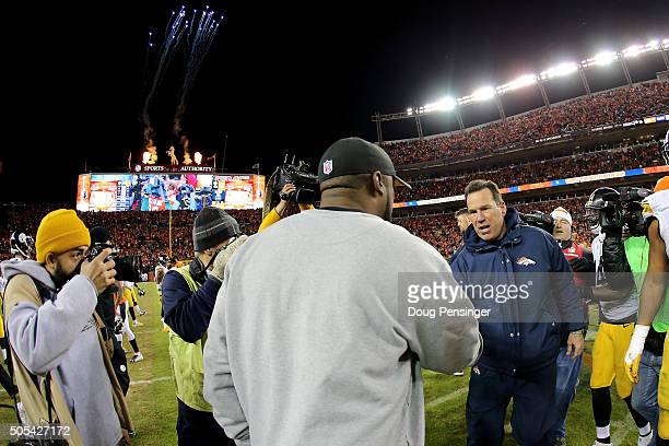 Head coach Gary Kubiak of the Denver Broncos and head coach Mike Tomlin of the Pittsburgh Steelers meet on the field after the AFC Divisional Playoff...