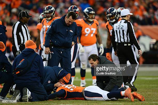 Head coach Gary Kubiak of the Denver Broncos and medical staff tend to linebacker Zaire Anderson of the Denver Broncos in the third quarter of the...