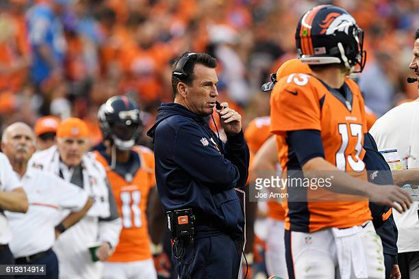 head coach Gary Kubiak of the Denver Broncos coaches as Trevor Siemian takes the field against the San Diego Chargers during the fourth quarter of...