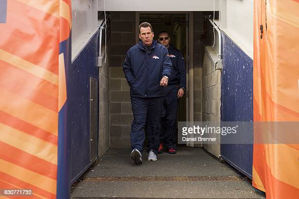 Head coach Gary Kubiak of the Denver Broncos exits the tunnel and on to the field before the game against the Oakland Raiders at Sports Authority...