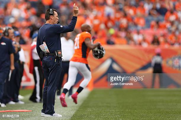 Head coach Gary Kubiak of the Denver Broncos gestures during the game against the Atlanta Falcons at Sports Authority Field at Mile High on October 9...