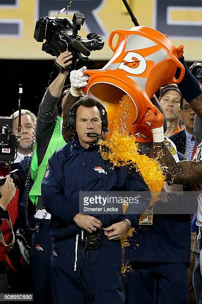 Head coach Gary Kubiak of the Denver Broncos is splashed with Gatorade in the final moments their Super Bowl 50 win at Levi's Stadium on February 7...