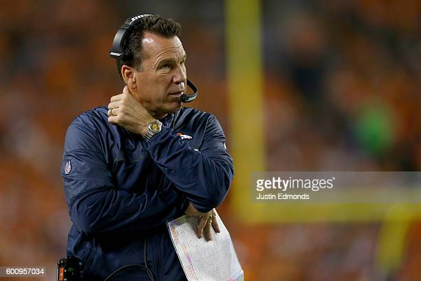 Head coach Gary Kubiak of the Denver Broncos looks on in the second half while taking on the Carolina Panthers at Sports Authority Field at Mile High...