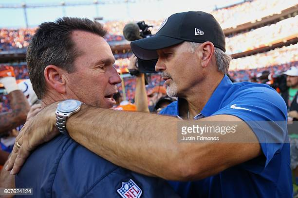 Head coach Gary Kubiak of the Denver Broncos shakes hands with head coach Chuck Pagano of the Indianapolis Colts after the broncos won 3420 at Sports...