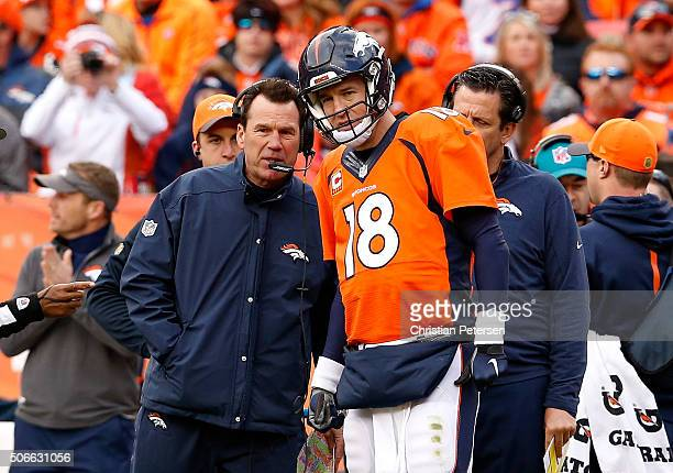 Head coach Gary Kubiak of the Denver Broncos speaks to Peyton Manning in the first half against the New England Patriots in the AFC Championship game...
