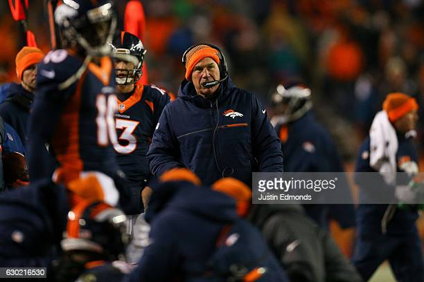 Head coach Gary Kubiak of the Denver Broncos walks on the sideline in the fourth quarter of a game against the New England Patriots at Sports...
