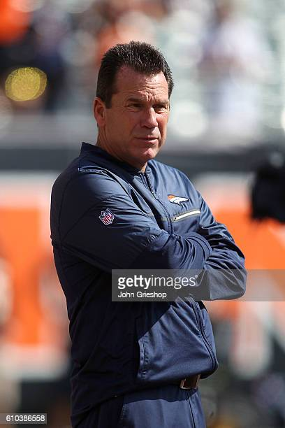 Head Coach Gary Kubiak of the Denver Broncos watches as his players warm up prior to the start of the game against the Cincinnati Bengals at Paul...