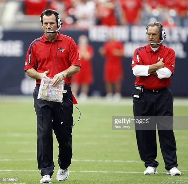 Head coach Gary Kubiak of the Houston Texans left and assistant head coach/offense Alex Gibbs look on during the game against the Jacksonville...