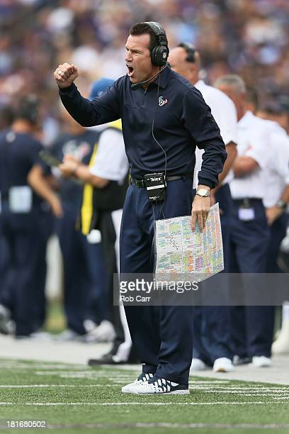 Head coach Gary Kubiak of the Houston Texans motions from the sidelines during the first half of their 309 loss to the Baltimore Ravens at MT Bank...