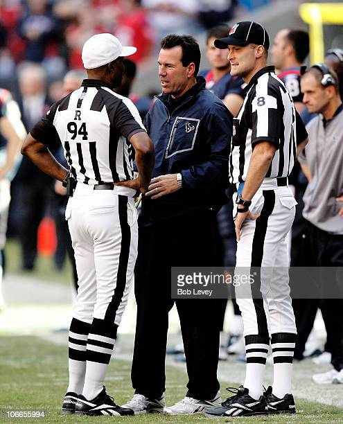 Head coach Gary Kubiak of the Houston Texans talks with referee Mike Carey and head linesman Dana McKenzie during game action at Reliant Stadium on...