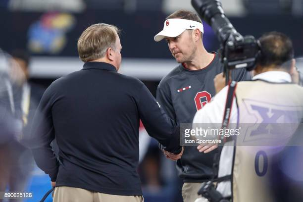 TCU head coach Gary Patterson and Oklahoma Sooners head coach Lincoln Riley talk at mid field during the Big 12 Championship game between the...