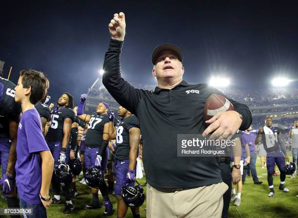 Head coach Gary Patterson of the TCU Horned Frogs holds his arm up as the band plays the alma mater after the 247 win over the Texas Longhorns at...