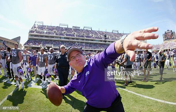 Head coach Gary Patterson of the TCU Horned Frogs throws a game ball into the stands after the Horned Frogs beat the Texas Longhorns 507 at Amon G...