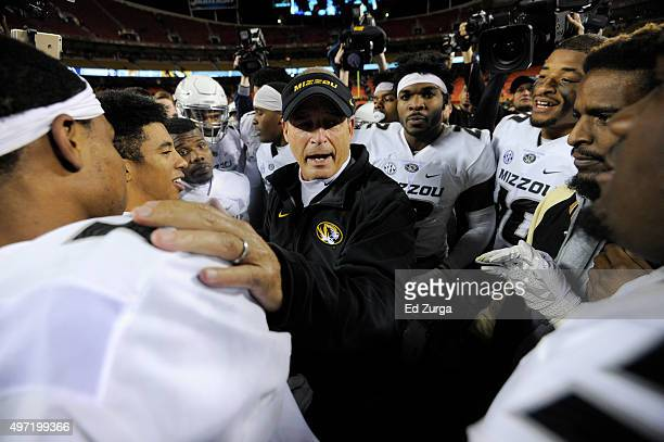Head coach Gary Pinkel of the Missouri Tigers talks with members of his team after a 2016 win over the Brigham Young Cougars at Arrowhead Stadium on...