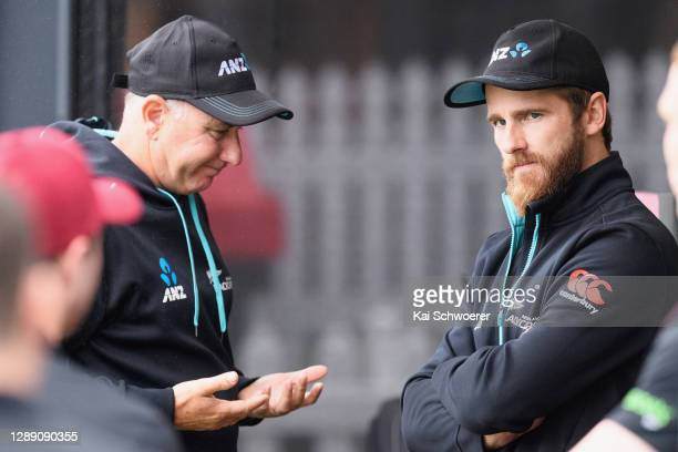 Head Coach Gary Stead and captain Kane Williamson of New Zealand look on as rain delays play during day one of the First Test match in the series...