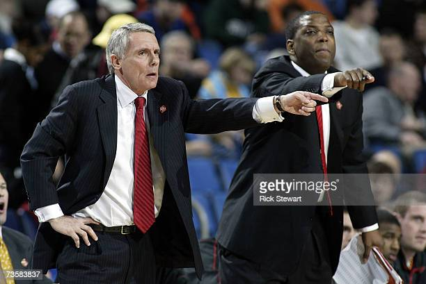 Head coach Gary Williams and assistant coach Keith Booth of the Maryland Terrapins point from the sidelines against the Davidson Wildcats during...