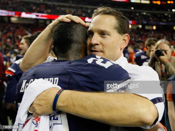 Head coach Gene Chizik of the Auburn Tigers celebrates with Onterio McCalebb after their 43-24 win over the Virginia Cavaliers during the 2011 Chick...