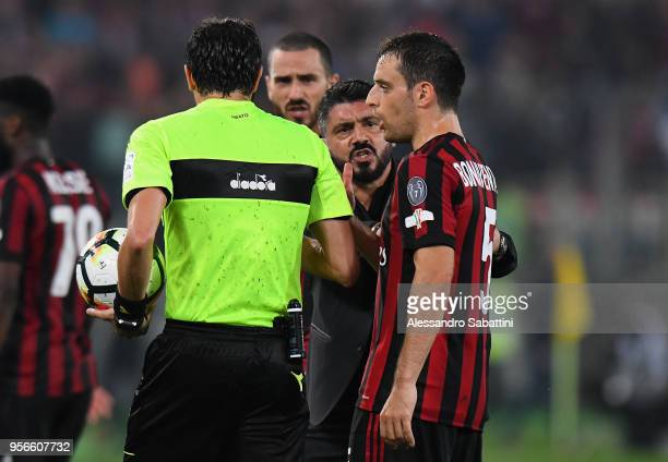 head coach Gennaro Gattuso of AC Milan chat with referee Antonio Damato during the TIM Cup Final between Juventus and AC Milan at Stadio Olimpico on...