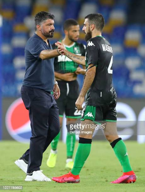 Head coach Gennaro Gattuso of Napoli and Francesco Magnanelli of US Sassuolo give themselves a handshake after the Serie A match between SSC Napoli...
