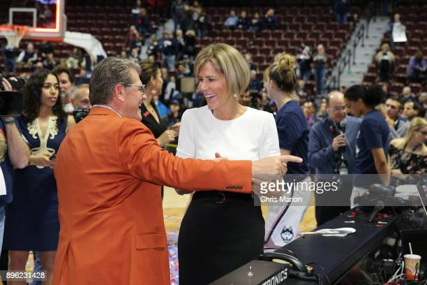 Head coach Geno Auriemma and Chris Dailey of the UConn Huskies after recording his 1000th win as head coach during the Naismith Basketball Hall of...