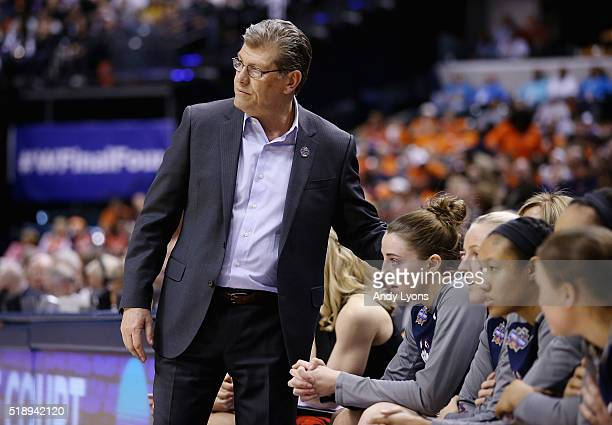 Head coach Geno Auriemma of the Connecticut Huskies consoles Katie Lou Samuelson who sits on the bench due to an injury as they play against the...