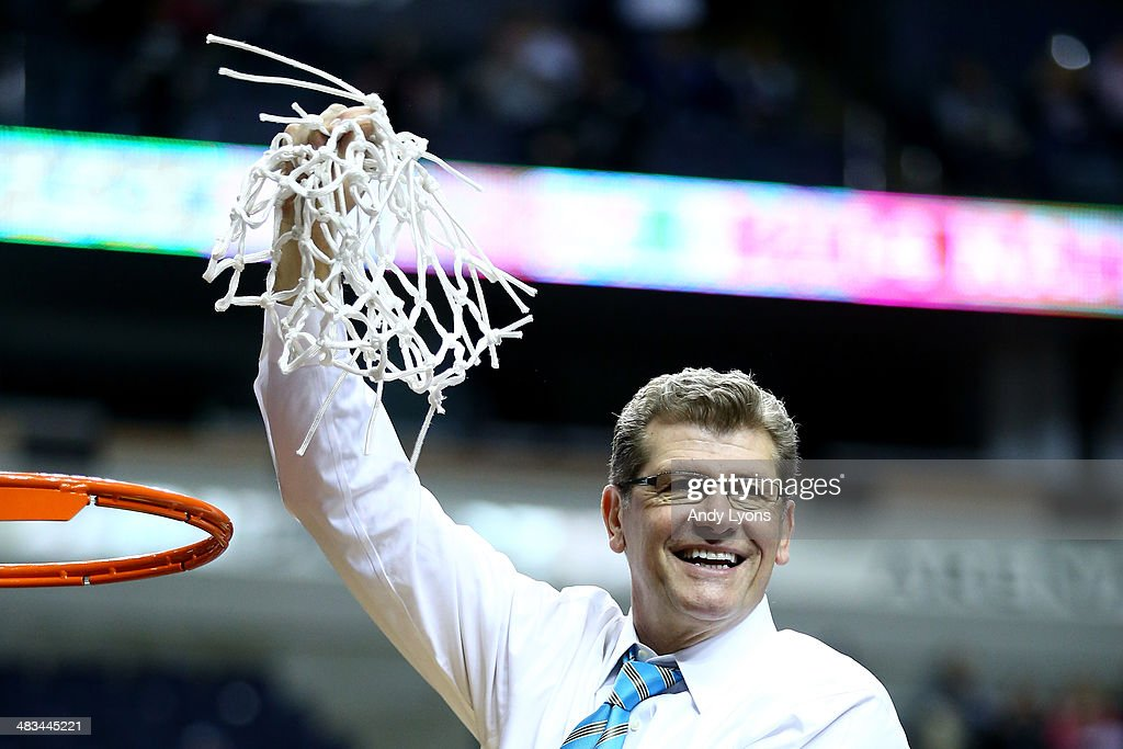Head coach Geno Auriemma of the Connecticut Huskies cuts down the net after defeating the Notre Dame Fighting Irish 79 to 58 in the NCAA Women's Final Four Championship at Bridgestone Arena on April 8, 2014 in Nashville, Tennessee.