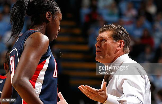 Head coach Geno Auriemma of the Connecticut Huskies talks with Tina Charles during the game against the North Carolina Tar Heels on January 19 2009...