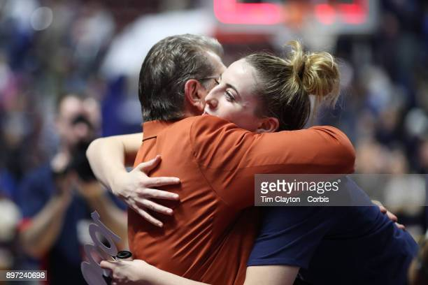 Head coach Geno Auriemma of the UConn Huskies is embraced by Katie Lou Samuelson of the Connecticut Huskies after ecording his 1000th win as head...