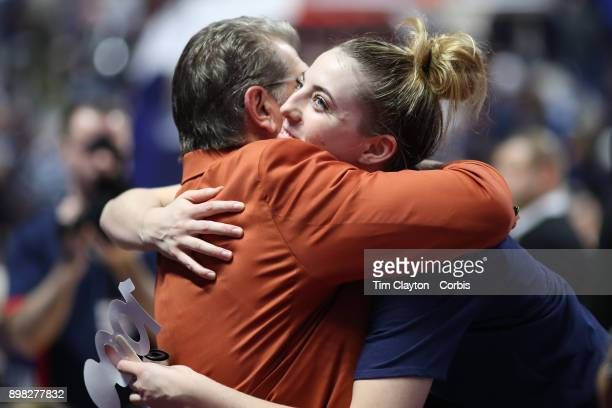 Head coach Geno Auriemma of the UConn Huskies is embraced by Katie Lou Samuelson of the Connecticut Huskies after recording his 1000th win as head...