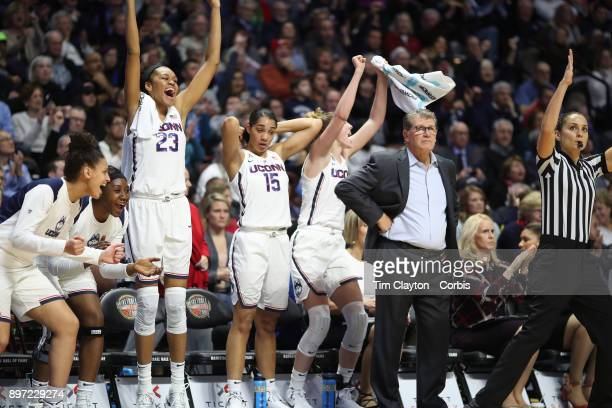 Head coach Geno Auriemma of the UConn Huskies on the sideline while recording his 1000th win as head coach of the team as the bench of Azura Stevens...