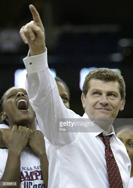 Head coach Geno Auriemma of the University of Connecticut Huskies celebrates after defeating the Tennessee Lady Vols 7061 in the National...