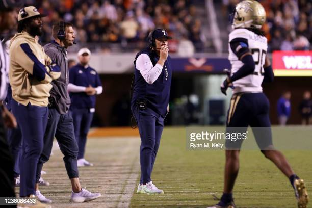 Head coach Geoff Collins of the Georgia Tech Yellow Jackets watches a replay in the second half during a game against the Virginia Cavaliers at Scott...