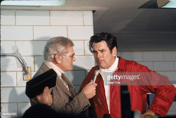 Head coach George Allen of the Washington Redskins talks with broadcaster Jack Whittaker of CBS in the locker room after the 1972 NFC Championship...
