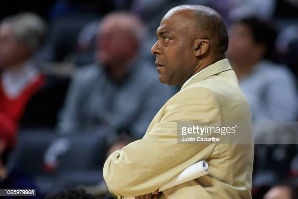 Head coach George Ivory of the ArkansasPine Bluff Golden Lions watches his team in the game against the Cincinnati Bearcats in the first half at...