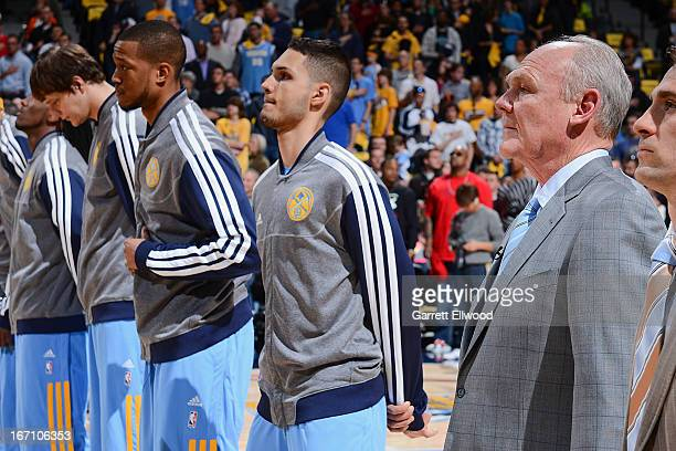 Head Coach George Karl of the Denver Nuggets and Evan Fournier listen to the National Anthem before playing against the Golden State Warriors in Game...