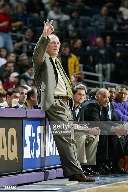 Head coach George Karl of the Milwaukee Bucks gives a hand signal during the game against the San Antonio Spurs at Bradley Center on March 11 2003 in...