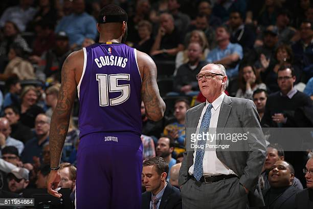 Head coach George Karl of the Sacramento Kings talks to DeMarcus Cousins of the Sacramento Kings as they face the Denver Nuggets at Pepsi Center on...