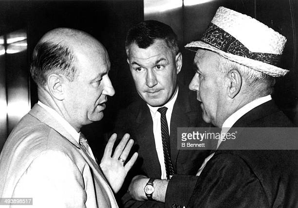 Head coach George 'Punch' Imlach of the Toronto Maple Leafs general manager Joe Crozier of the Rochester Americans and former NHL linesman Ernie...