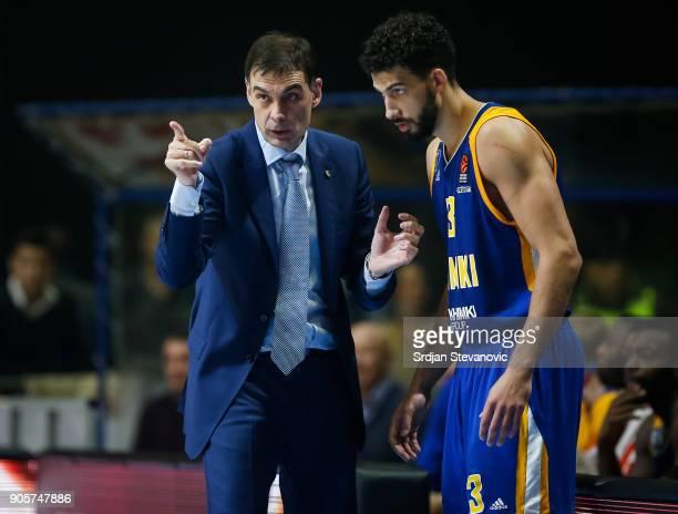 Head coach Georgios Bartzokas of Khimki talk to the Anthony Gill during the 2017/2018 Turkish Airlines EuroLeague Regular Season Round 18 game...