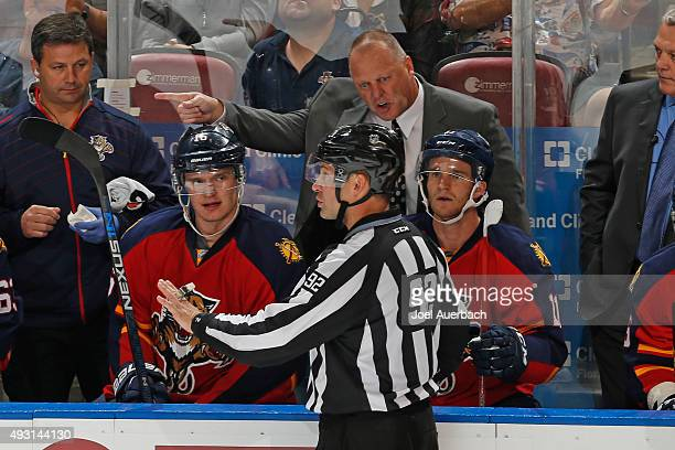 Head coach Gerald Gallant of the Florida Panthers argues a call with linesman Mark Shewchyk during third period action against the Dallas Stars at...