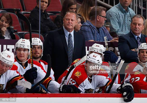 Head coach Gerard Gallant of the Florida Panthers watches from the bench during the NHL game against the Arizona Coyotes at Gila River Arena on...