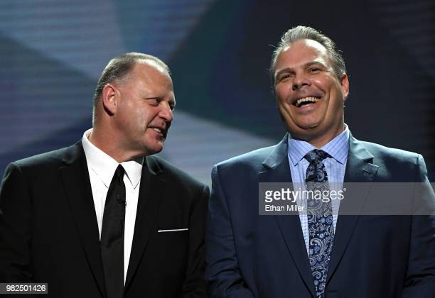 Head coach Gerard Gallant of the Vegas Golden Knights and general manager Kevin Cheveldayoff of the Winnipeg Jets share a laugh onstage before the...