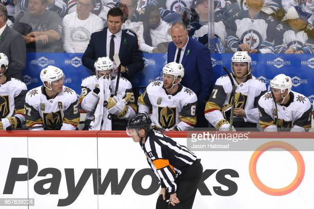 Head coach Gerard Gallant of the Vegas Golden Knights argues with referee Kelly Sutherland against the Winnipeg Jets during the third period in Game...
