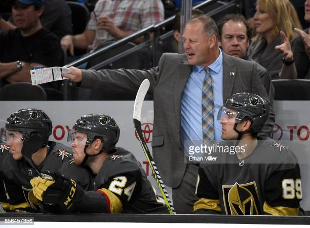 Head coach Gerard Gallant of the Vegas Golden Knights handles bench duties during the team's preseason game against the San Jose Sharks at TMobile...
