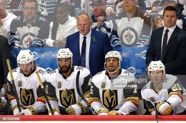 Head Coach Gerard Gallant of the Vegas Golden Knights looks on from the bench during second period action against the Winnipeg Jets in Game One of...