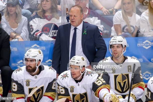 Head Coach Gerard Gallant of the Vegas Golden Knights looks on from the bench during third period action against the Winnipeg Jets in Game Five of...