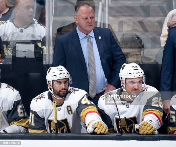 Head coach Gerard Gallant of the Vegas Golden Knights looks on with PierreEdouard Bellemare and William Carrier on the bench during the second period...