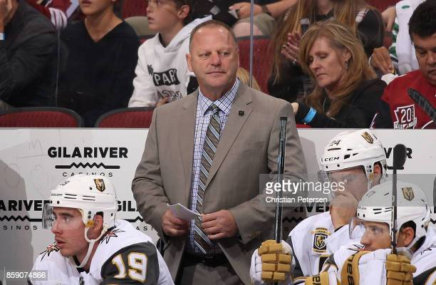 Head coach Gerard Gallant of the Vegas Golden Knights watches from the bench during the first period of the NHL game against the Arizona Coyotes at...