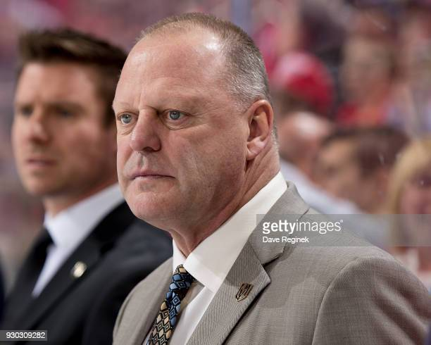 Head coach Gerard Gallant of the Vegas Golden Knights watches the action from the bench against the Detroit Red Wings during an NHL game at Little...