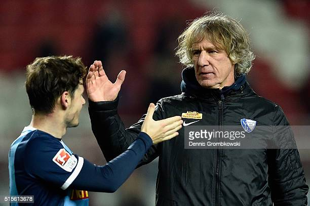 Head coach Gertjan Verbeek of VfL Bochum high fives with Stefano Celozzi after the Second Bundesliga match between 1 FC Kaiserslautern and VfL Bochum...